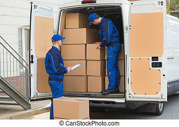 Delivery Men Unloading Boxes - Delivery man unloading...