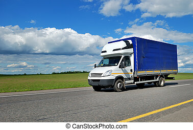 Delivery minitruck with white cabin and blue trailer - ...