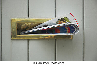 Delivery of news - Magazine delivered into letterbox.