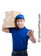 Delivery Person. Asian postman with parcel box gesture OK sign.
