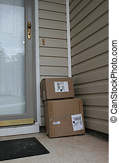 Delivery - Packages outside door of a house