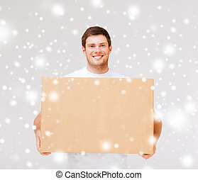 smiling man carrying carton box - delivery, post, package ...