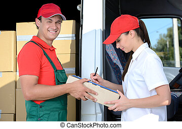 Delivery - Smiling young man and woman postal delivery ...