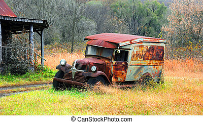 Delivery Truck Rusts Besides Cabin - Old Ford delivery truck...