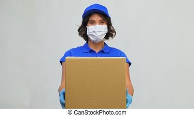 delivery woman in face mask holding parcel box - health ...