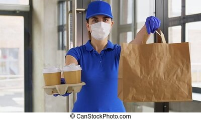 delivery woman in face mask with food and drinks - health ...