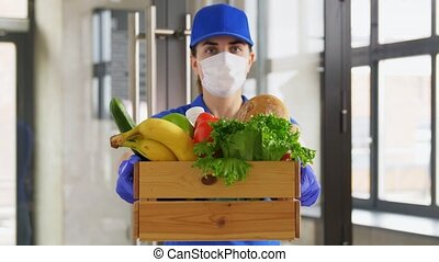 delivery woman in face mask with food in box - health ...