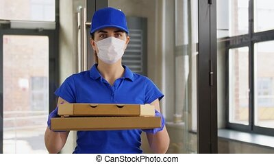 delivery woman in face mask with pizza boxes - health ...