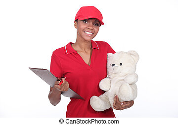 Delivery woman smiling on white background