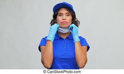 delivery woman wearing protective mask and gloves - health ...