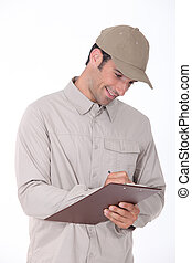 Delivery worker checking clipboard