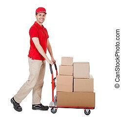 deliveryman, à, a, chariot, de, boîtes