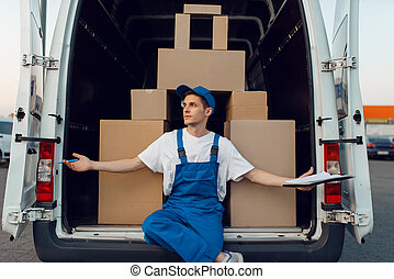 Deliveryman at the car, boxes in a pyramid shape