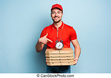 Deliveryman is punctual to deliver quickly pizzas. Cyan background
