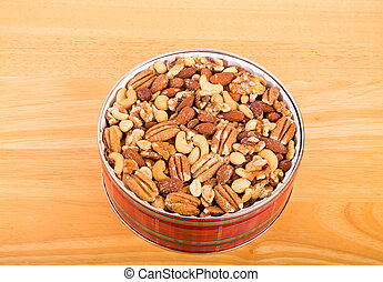 Deluxe Mixed Nuts in a Christmas Tin on Wood Table