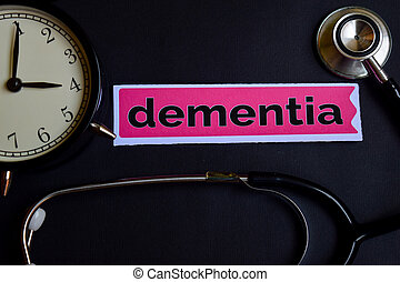 Dementia on the print paper with Healthcare Concept Inspiration. alarm clock, Black stethoscope.