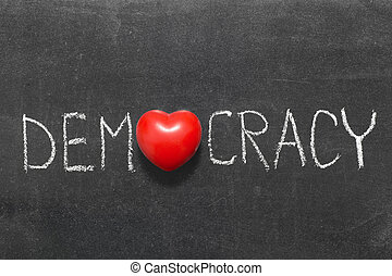 democracy word handwritten on blackboard with heart symbol...