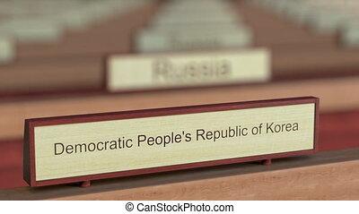 Democratic People's Republic of Korea DPRK name sign among...