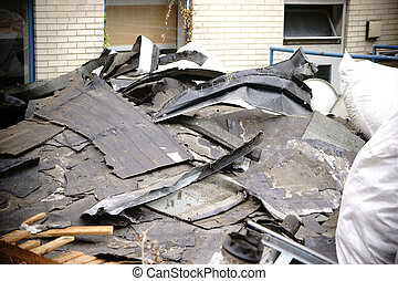 Demolished roof-top - The close-up of debris from rubble and...