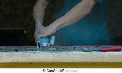 Demolishing Old Wooden Window