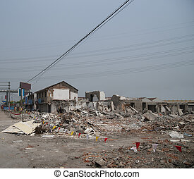 Demolishing site with heaps of debris in China