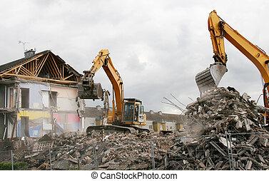 Demolition 1 - A digger demolishing houses for...