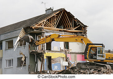 A digger demolishing houses for reconstruction.