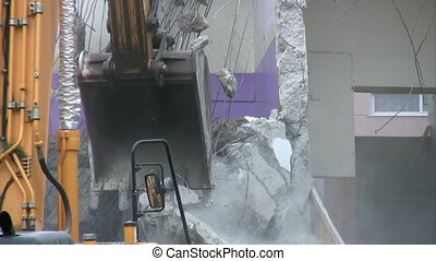 Demolition - bulldozer working at a demolition site