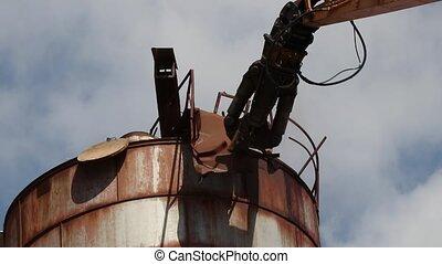 Demolition crane destroy rusty metal construction -...