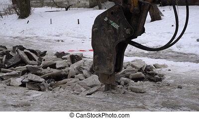 Demolition Hammer crushes pavement - Demolition Hammer...