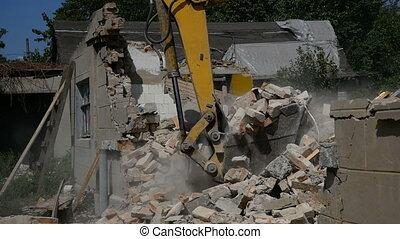 Demolition house using excavator in city. Rebuilding process.