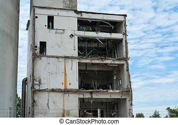 Demolition of a building house in a construction site