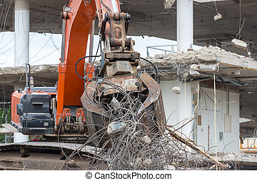 Demolition of a building with concrete floors and pillars