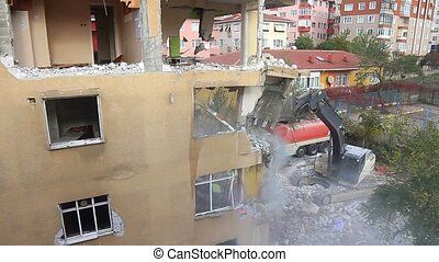 Demolition of a house with a digger - Turkey sits on a...
