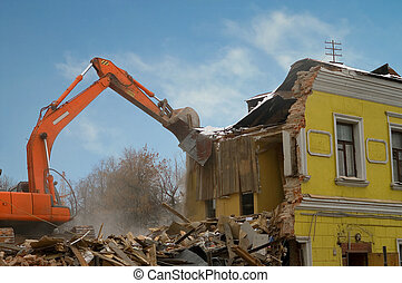 Demolition of an old house with power shovel