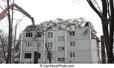 Demolition of building in urban environments with heavy machinery