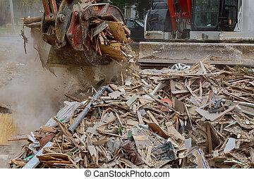 Demolition of wooden house in trash debris outside of neighborhoods devastated by hurricane