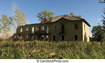 Demolition old house. excavator destroys old brick...