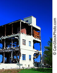 Demolition against vivid blue sky
