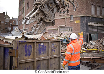 demolition squad destroy an old building to start a new...