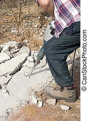 Demolition - Man demolishing concrete
