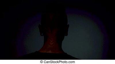 Demon face makeup on mans face.