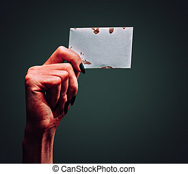 Demon hand with blank card