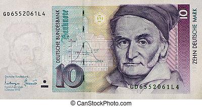 Demonetised German deutsche marks - A 10 German mark note,...