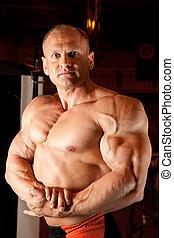 demonstra, bodybuilder, seu, músculos