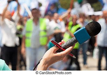 demonstration., microphone., public