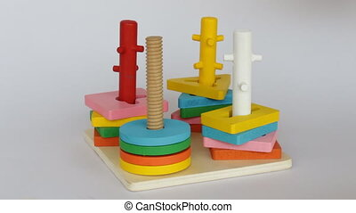 Demonstration of colorful puzzle wooden toy, stock video