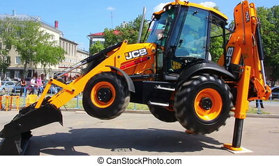 demonstration of multifunctional tractor at the exhibition