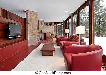 Den with red chairs