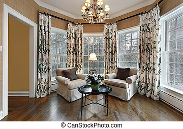 Den in upscale home with wall of windows